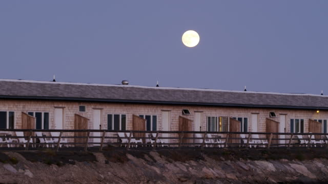 Supermoon over beachfront motel