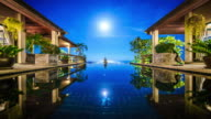 Supermoon rising over the pool at the villa time lapse 4K
