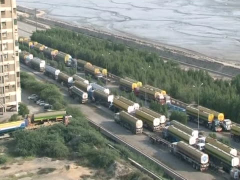 NATO supply vehicles queuing in Pakistan at the border with Afghanistan which was closed following a 'friendly fire' bombing incident resulting in...