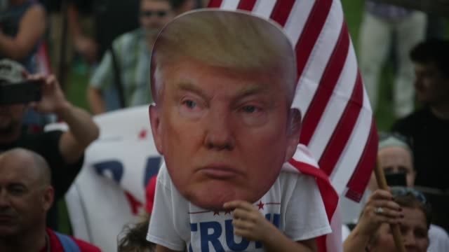 "A supporter wears a mask of US President Donald Trump during a ""Mother of All Rallies"" Hundreds of supporters of US President Donald Trump from..."