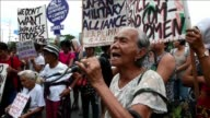 Supporters and family members of Filipina comfort women hold a protest in front of the Japanese embassy in Manila ahead of Japanese Prime Minister...