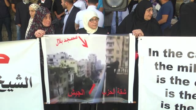 Supporters and relatives of Sheikh Ahmad alAssir who has been sentenced to death over Sidon clashes in 2013 stage a protest outside the Military...