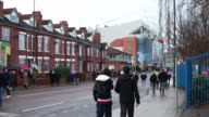 Supporters arrive at Manchester United's Old Trafford Stadium in Salford north west England on January 26 Manchester United's Old Trafford Stadium at...