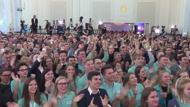 Supporters at the Austrian People's Party cheer and applaud as exit polls after a snap election place the party in the lead with 302% of the vote