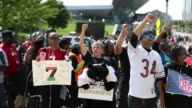 Supporters gather outside of Soldier Field for a rally to support former San Francisco 49ers quarterback Colin Kaepernick on September 10 2017 in...