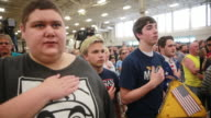 Supporters of 2016 presidential candidate Donald Trump say the Pledge of Allegiance before Trump's appearance at the Indiana State Fairgrounds Trump...
