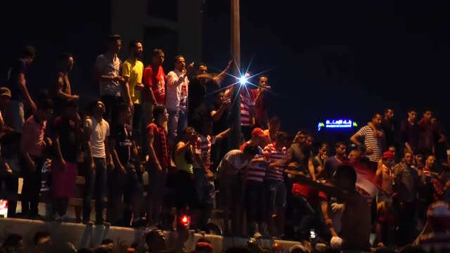 Supporters of Club Africain celebrate their team's championship after they have beaten ES Zarzis within Tunisian Soccer 1 League in Tunis Tunisia on...