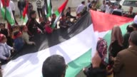 Supporters of Democratic Front for the Liberation of Palestine hold a big Palestinian flag as they gather in front of the United Nations office...