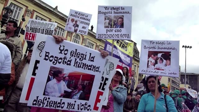 Supporters of dismissed Bogota Mayor Gustavo Petro take part in a demonstration after he was removed from office by the Attorney General and barred...