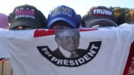 Supporters of Donald Trump president and chief executive of Trump Organization Inc and 2016 Republican Presidential candidate sell Donald Trump...