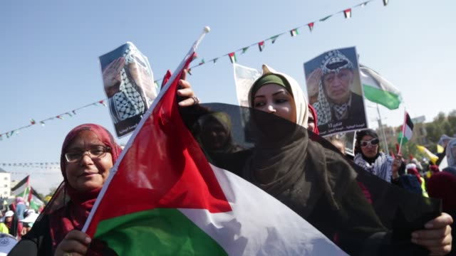 Supporters of former senior Fatah official Mohammad Dahlan take part in a rally marking the death anniversary of late Palestinian leader Yasser...