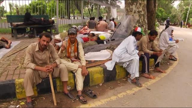 Supporters of Imran Khan leader of Pakistan TehreekeInsaaf and TahirulQadri leader of Pakistan Awami Tehreek demanding the resignation of prime...