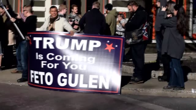 Supporters of Presidentelect Donald Trump of Republican Party place banners against Fetullah Terrorist Organization led by Fetullah Gulen near his...