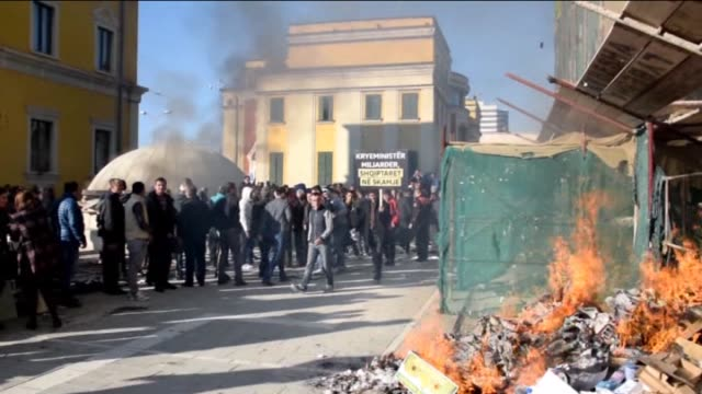 Supporters of the Democratic Party clashes with police during antigovernment protest in front of the office of Albanian Prime Minister Edi Rama in...