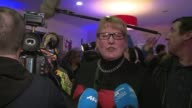 Supporters of the farright National Front party hail the first round victory of their candidate in the northern French city of Henin Beaumont CLEAN...