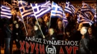 Supporters of the Greek farright Golden Dawn party take part in a rally to protest government's migrant policy on the International Day for the...
