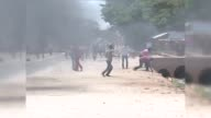 Supporters of the opposition candidate Raila Odinga set fire and block a road during a demonstration against the election results in Garissa Kenya on...