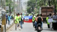 Supporters of the Verite political party in Haiti marched on Monday to demand the reinstatement of their presidential candidate Jacky Lumarque who...
