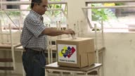 Supporters of Venezuelan President Maduro take part in a rival poll exercise on Sunday that serves as a dry run for the country's July 30 constituent...