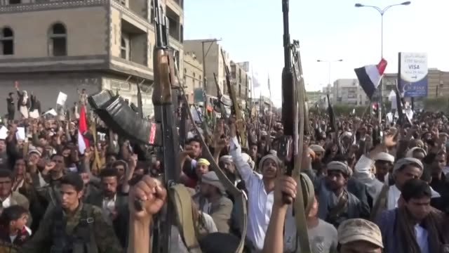 Supporters of Yemen's Houthi group stage a protest to demand Saudiled coalition operations to come to an end in Sanaa Yemen on 27 April 2015