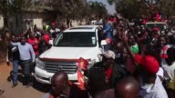 Supporters of Zambian opposition leader Hakainde Hichilema celebrate after he is released from prison and the treason charges against him dropped...