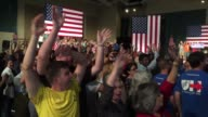 Supporters wait for Hillary Clinton at Palm Beach Convention Center