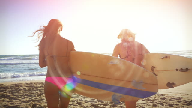 Surfer girls at sea