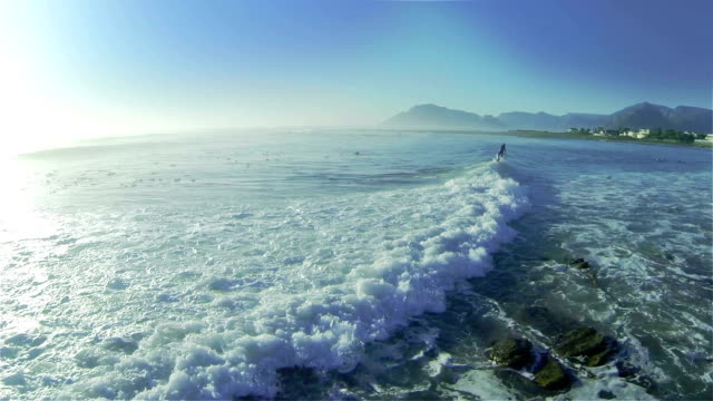 SLO MO of surfer riding a wave/ Western Cape/ South Africa