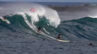 MS TS Surfers riding on waimea bay  / Haleiwa, Hawaii, United States