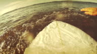 Surfing pov with action camera: paddling