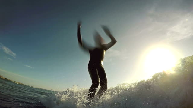 Surfing pov with action camera: taking waves