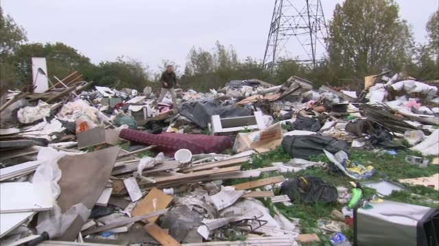 Surge in flytipping across England Location unknown Reporter to camera on huge pile of illegally dumped refuse Allison OgdenNewton interview SOT