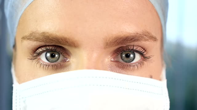 Surgeon face with blue eyes