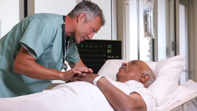 MS Surgeon Talking to Senior Patient in Hospital Bed / Richmond, Virginia, USA