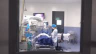 Surgeons and nurse operating a patients cataracts