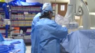Surgeons insert a leg stent at Advocate Christ Medical Center on March 03 2014 in Chicago Illinois