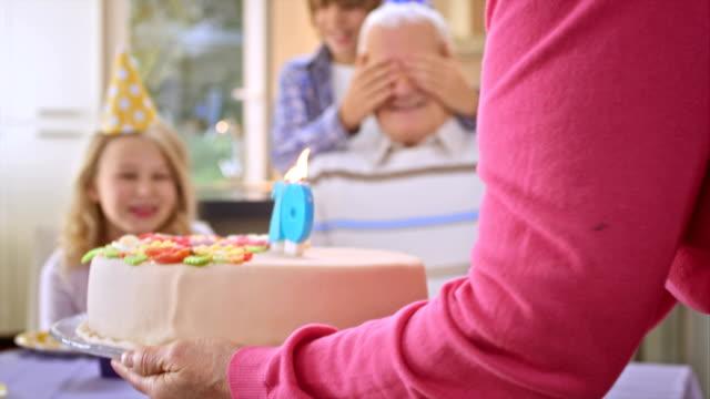 SLO MO surprise birthday cake for grandpa