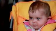 Surprised baby sitting in the pram