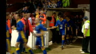 Kingston Kingsmeadow AFC Wimbledon team running out onto pitch for match AFC Wimbledon player scoring penalty