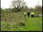 Surrey WaltononThames EXT Police officers walking thru allotments looking for clues to disappearance of Amanda Dowler Police officers searching...