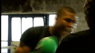Survey shows fall in violent crime ENGLAND East London Canning Town INT Boxers sparring in ring Close Shot Punch bag being punched Boxers sparring in...