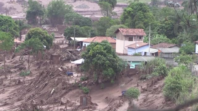 A survivor of a toxic mudslide caused by burst dams in a Brazil village recalls her ordeal a heartbreaking situation