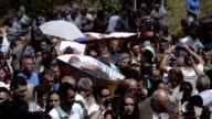 Survivors of 'near death experiences' are carried in coffins to church as part of festival