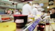 ECU Sushi moves around on a conveyer belt in a Tokyo restaurant / Tokyo, Japan