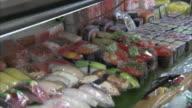 CU PAN Sushi on market stall, Tokyo, Japan