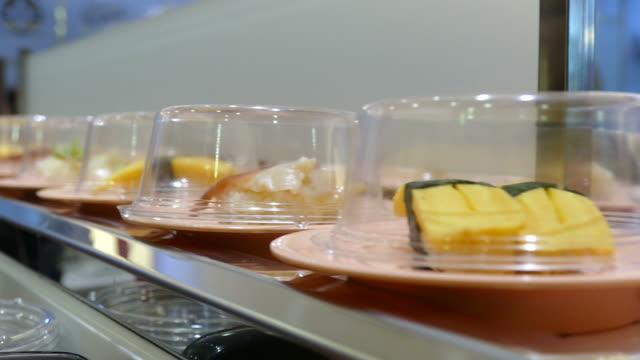sushi on serving line