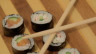 Sushi on wooden plate
