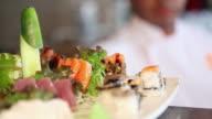 MS R/F Sushiman serving sushi and sashimi dish, typical Brazilian night life / Sao Paulo, Brazil
