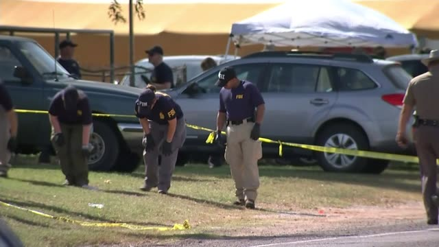 Gunman may have been targeting motherinlaw USA Texas Wilson County Sutherland Springs EXT Police investigators searching crime scene Sheriff officers...