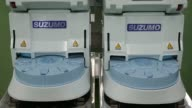 Suzumo Machinery Co SSNJLX compact sushi making machines sit at the company's factory in Kawashima Saitama Japan on Monday Aug 7 2017